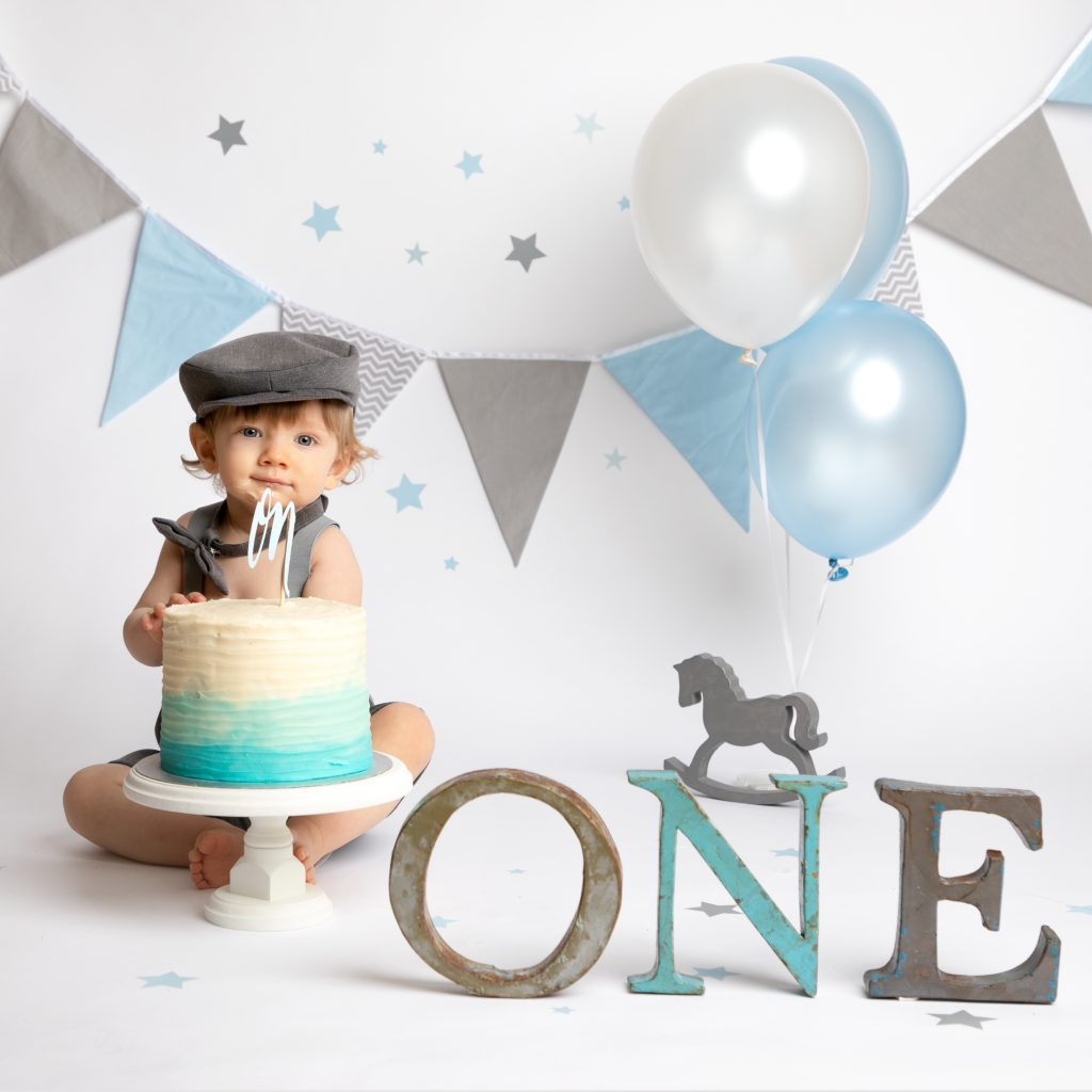 1st Birthday Cakesmash photoshoot with blue & grey bunting in Glasgow