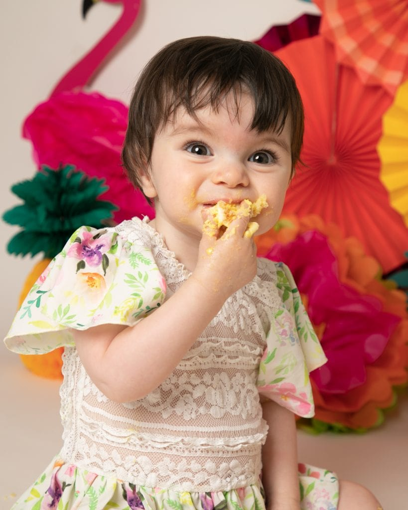 Baby girl eating cake at her 1st birthday photoshoot in Glasgow