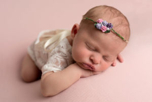 Baby on pink backdrop taken by haywards heath photographer