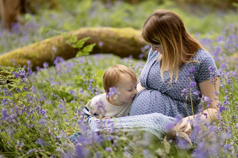 Pregnancy ohotoshoot outdoor in bluebells by pregnancy photographer in haywards heath