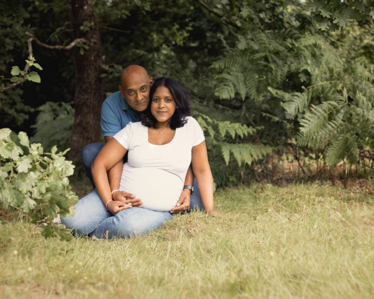 Outdoor pregnancy photoshoot, couple in woods