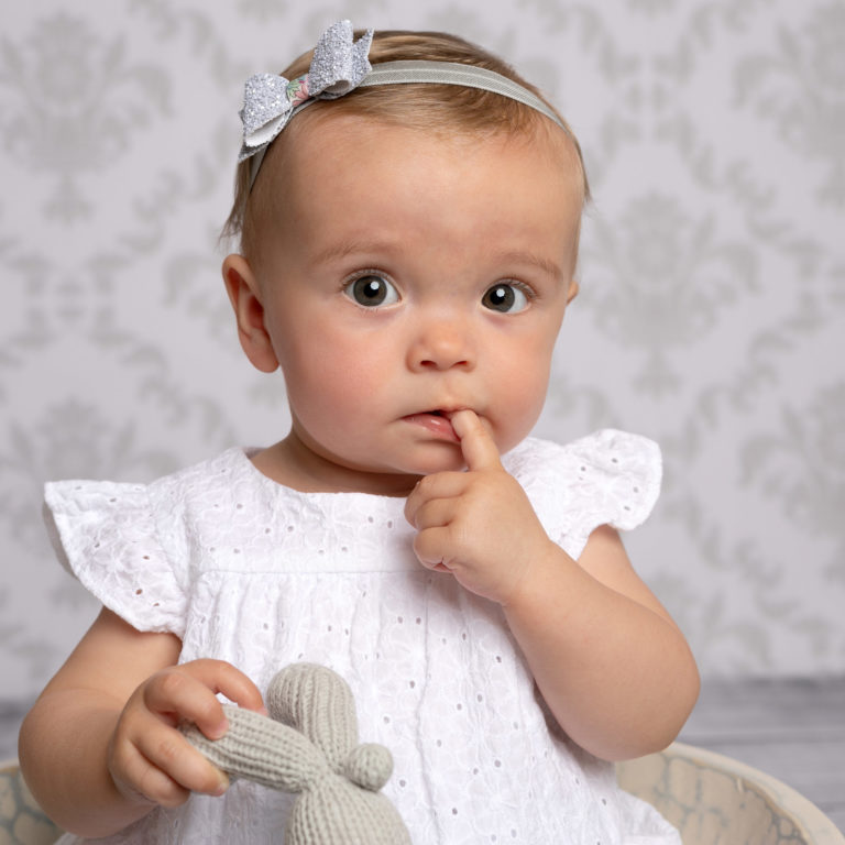 baby girl in white dress with Horsham baby photographer