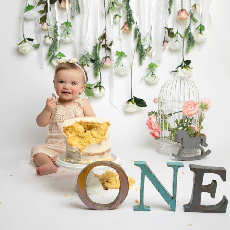 Baby photography cakesmash photoshoot floral backdrop with pastel tones in Haywards Heath