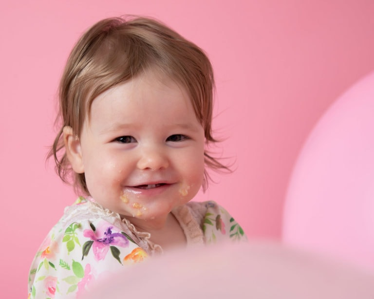 Pink cakesmash set up for baby photoshoot in Haywards Heath