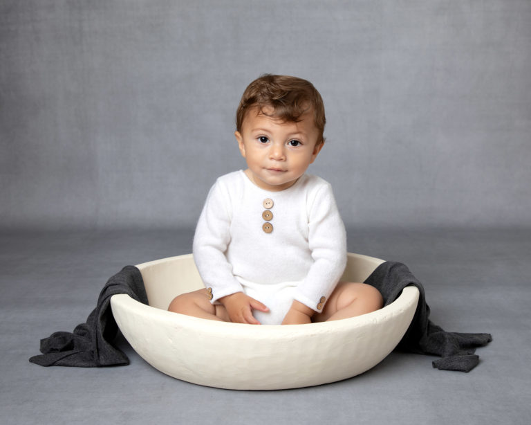 Baby boy in bowl during baby photography session