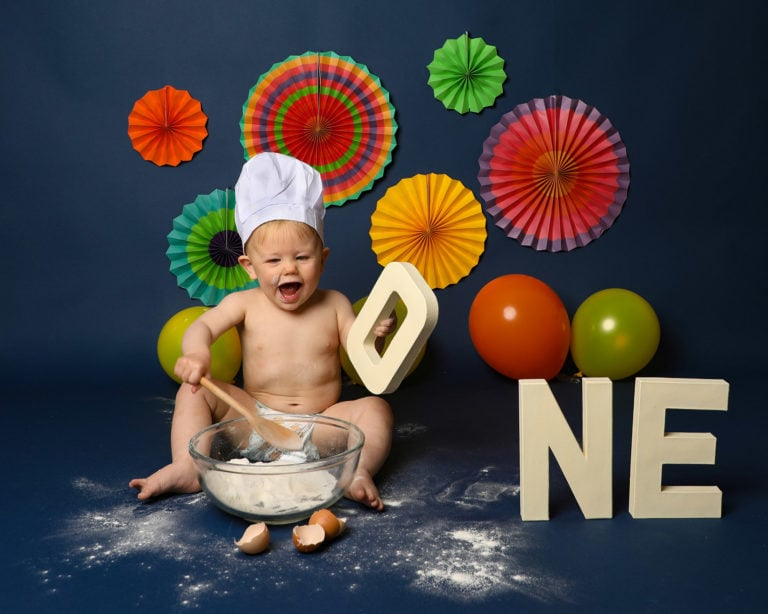 Bright colourful baby photoshoot in Haywards heath, themed cakesmash for boy or girl