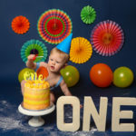 Bright colourful baby photoshoot cakesmash session for boy or girl in Haywards Heath