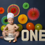 Bright colourful baby photoshoot, themed in studio in Haywards Heath by local photographer