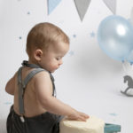 Baby photography cakesmash session with blue, white & silver balloons & props