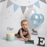 Baby photography cakesmash photoshoot with blue, white & silver balloons & props in Haywards Heath