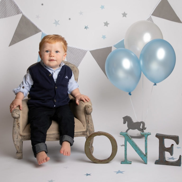 Haywards Heath photoshoot cakesmash session blue & silver theme with boy in suit