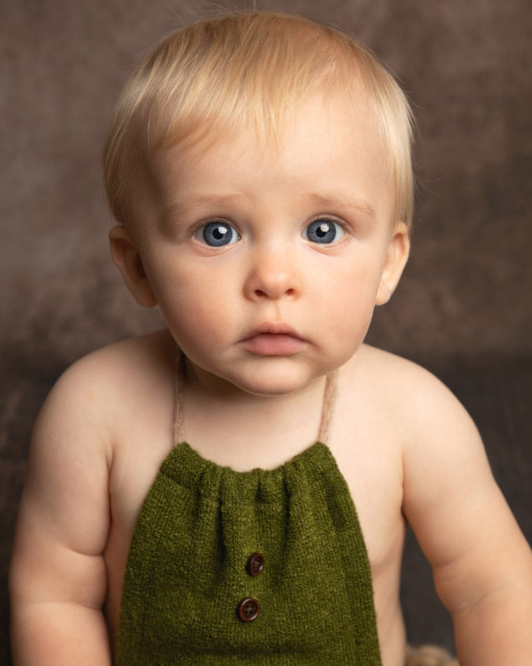 boy wearing green baby photography session
