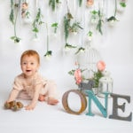 Baby photography cakesmash session, floral backdrop with pastel tones