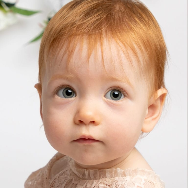 Baby photoshoot cakesmash session, floral backdrop with pastel tones Haywards Heath