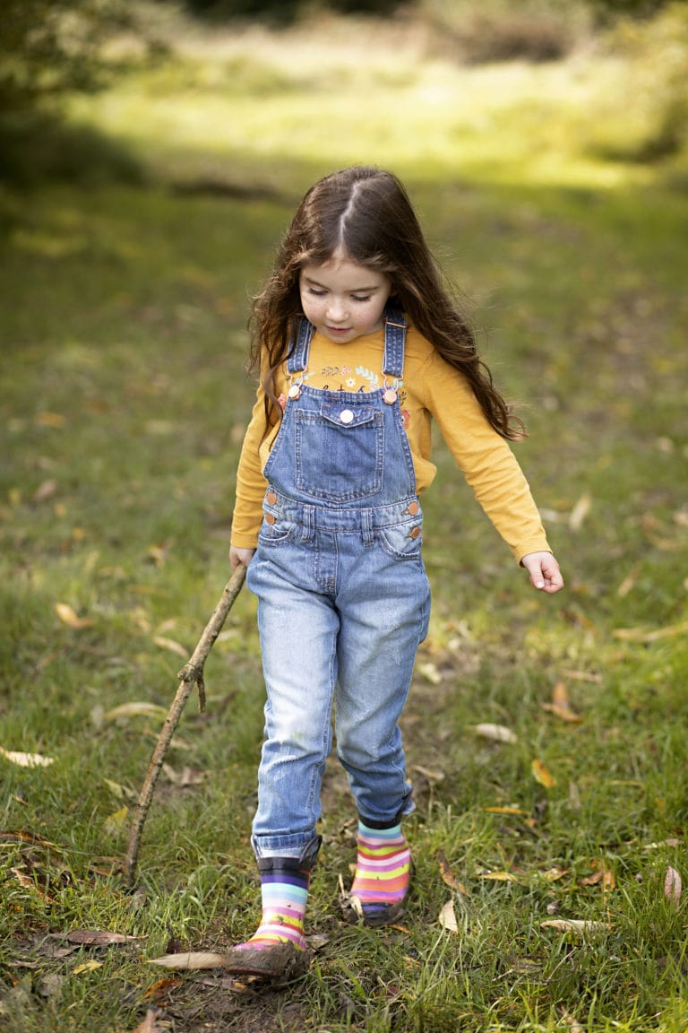 Girl walking during Autumn family photoshoot by family photographer Haywards Heath