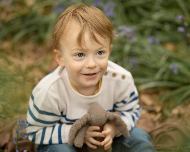 Family photographer captures boy photographed with his toy bunny in woodland in Haywards Heath