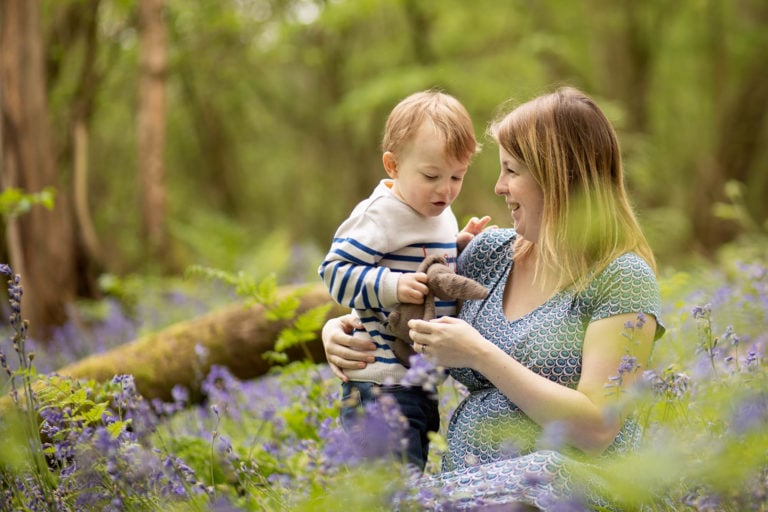 boy & mum chatting in bluebells in Haywards Heath taken by family photographer