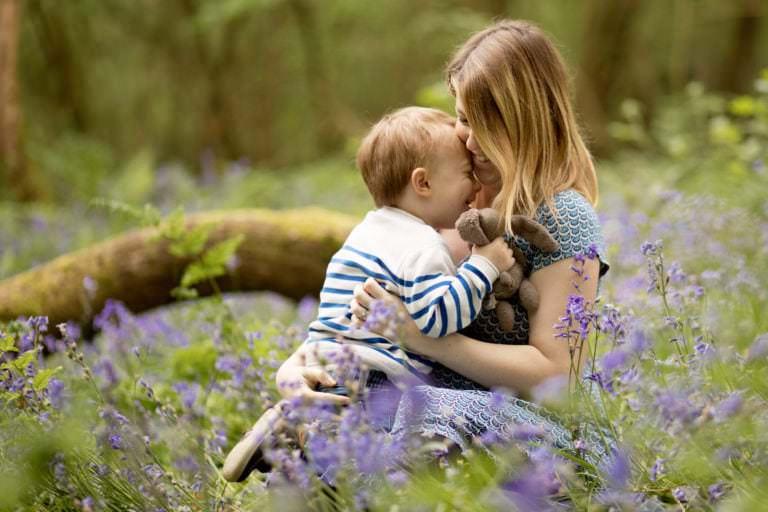 boy hugging mummy in blubells in Haywards heath by family photographer