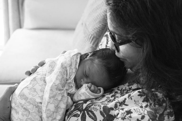 Baby asleepon mums chest by haywards heath photographer