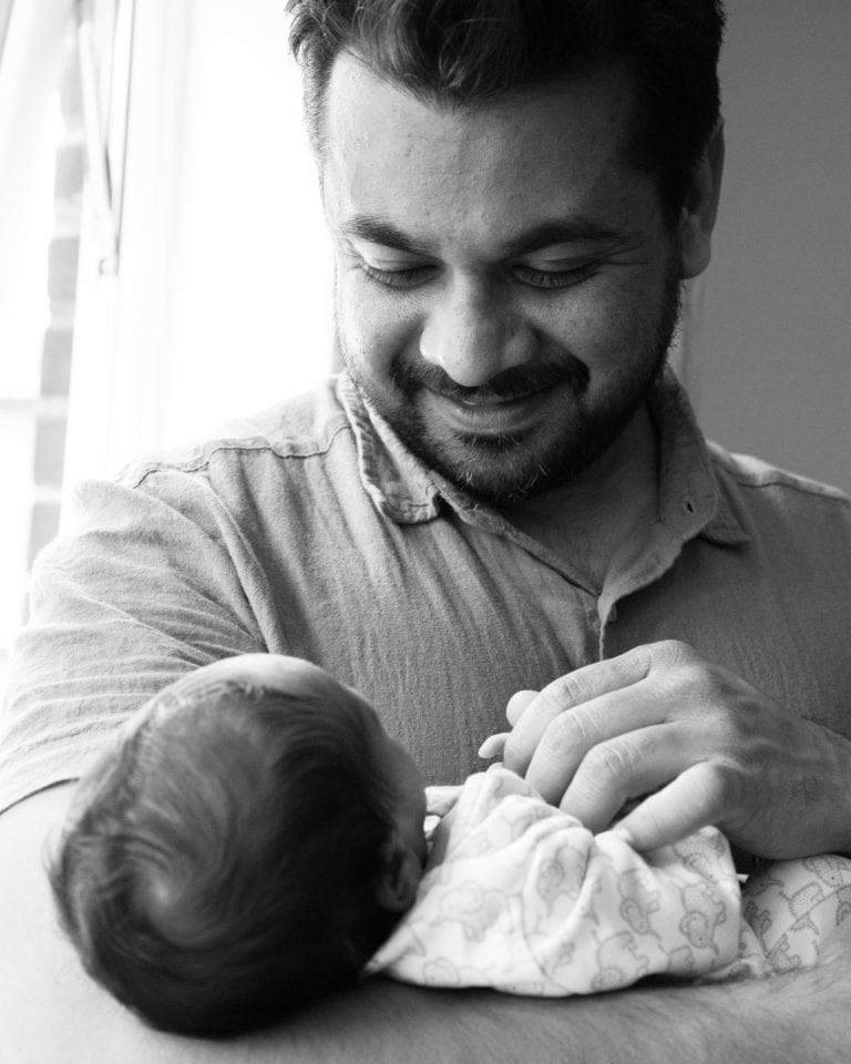 by haywards heath photographer dad holding baby boy