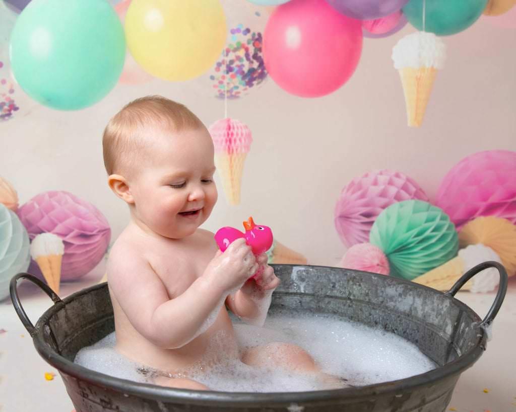 Baby in tin bath following 1st birthday cakesmash photoshoot in Glasgow