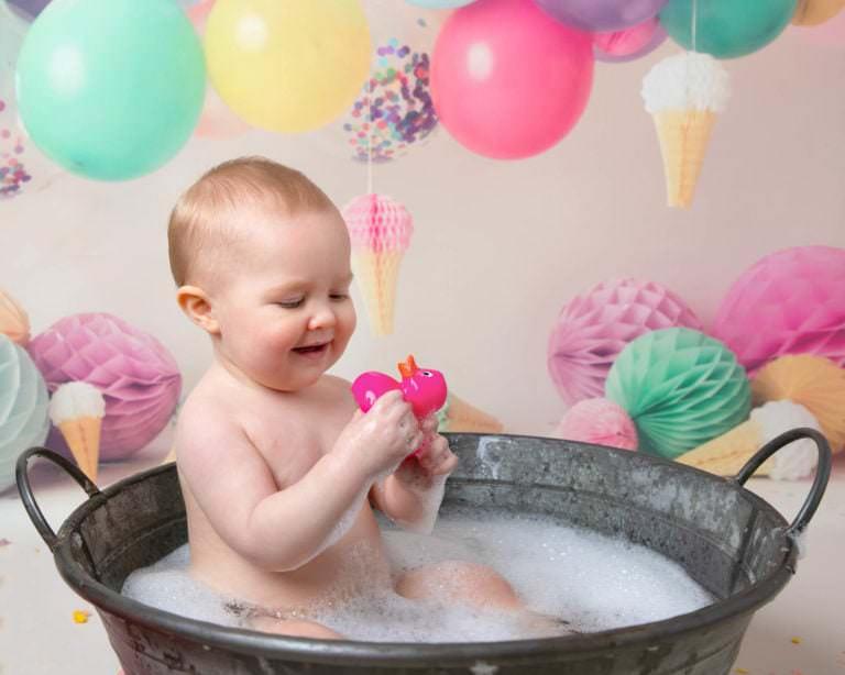Baby in tin bath following cakesmash photoshoot in haywards heath
