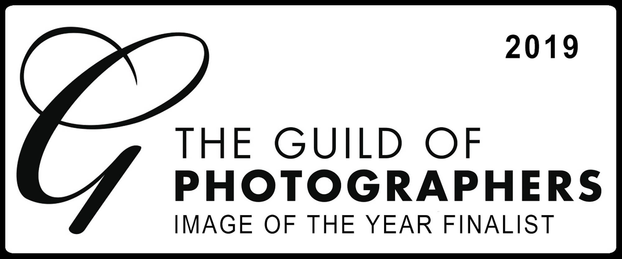 white rectangular image with large G on left and bold writing stating Guild of Photographer Image of the year finalist. 2019. Awarded to Glasgow Baby Photographer Louise Ferguson