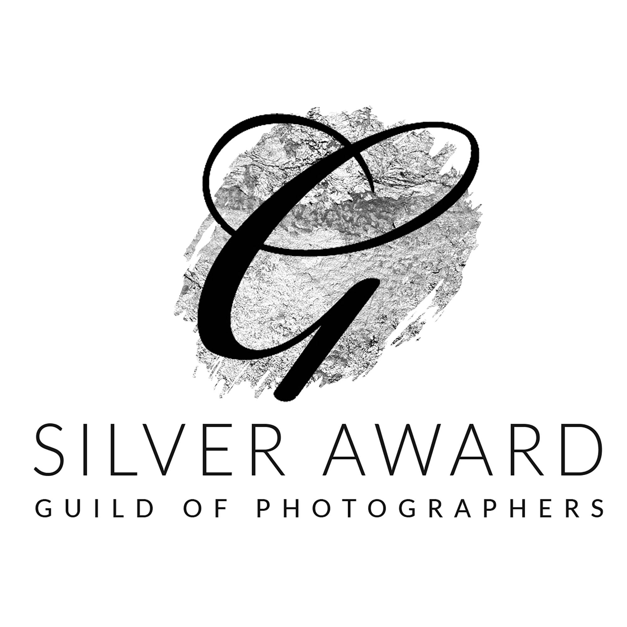 Guild silver award winner's logo. Large G with words Silver Award, Guild of Photographers. Awarded to Glasgow Baby Photographer, Louise Ferguson