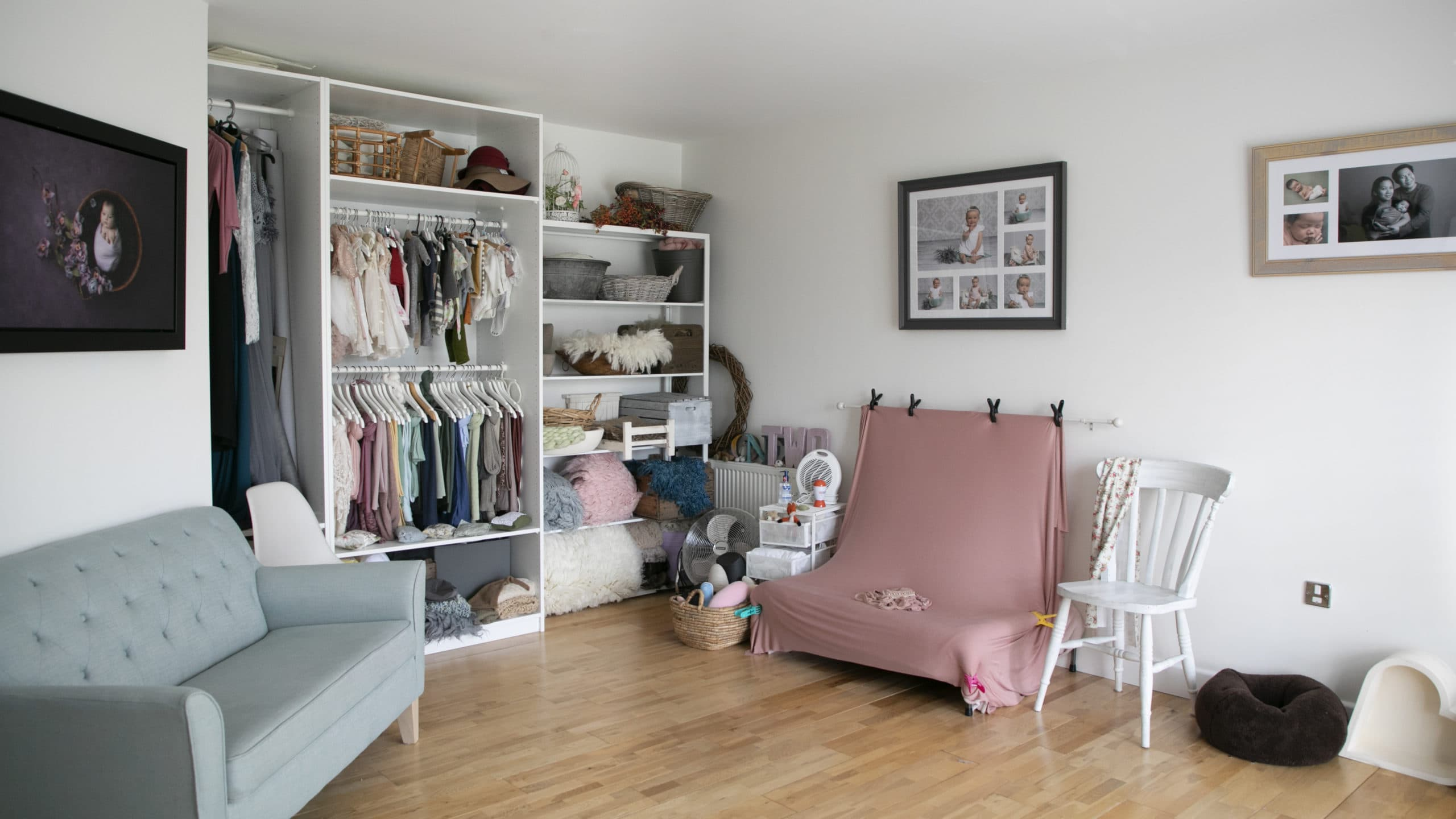 Baby Photographer Glasgow. Image of studio, with shelves, props and posing bed on display